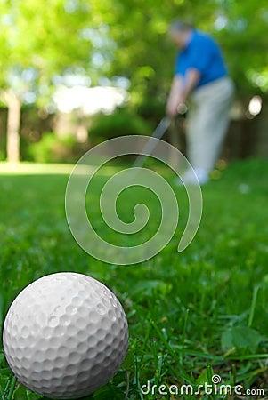 Golf ball and golfer