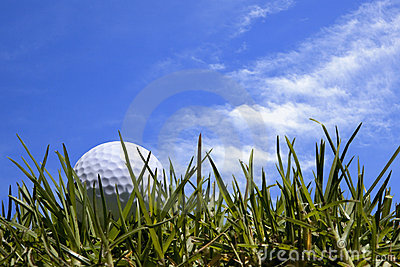 Golf Ball in Grass with Blue Sky