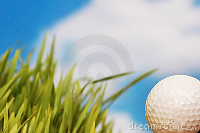 Golf ball and green grass agai
