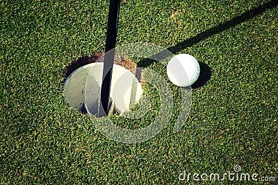 Golf Ball at Hole