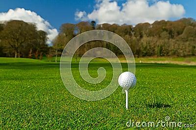 Golf ball on an idyllic course