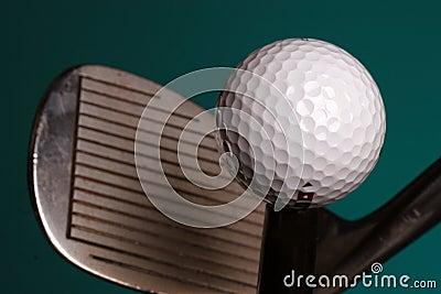 Golf ball and iron