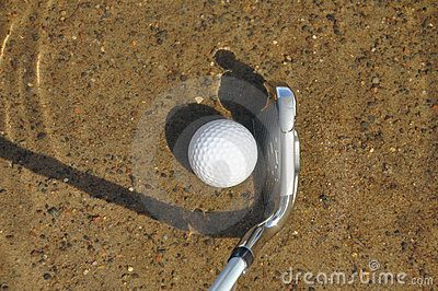 Golf Ball and Iron in a Water Hazard