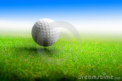 Golf ball on meadow