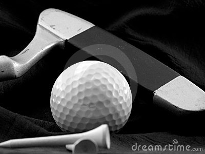 Golf ball, putter and tee.