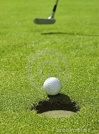 Golf ball rolling towards the hole