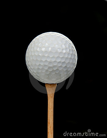 Golf ball on tee on black