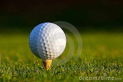 Golf Ball on tee close up