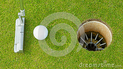 Golf ball and tee on green cours