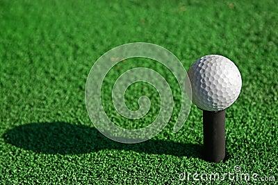 Golf ball on tee and imitate green