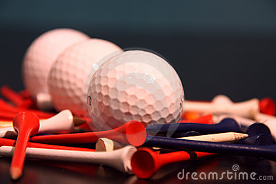 Golf ball and tees lined up