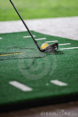 Golf ball on training mate