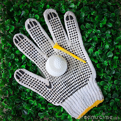 Golf ball and yellow tee on hand gloves