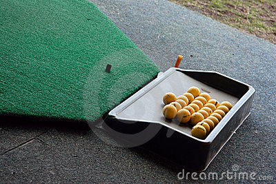 Golf balls in a rack