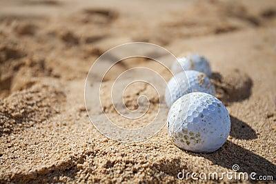 Golf balls in a sand