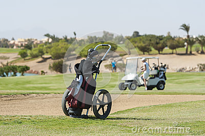 Golf caddy trolley on fairway