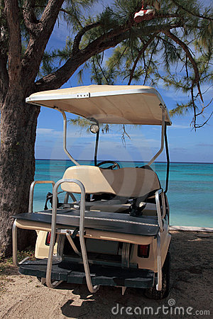 Golf cart on beach at tropical island resort hotel
