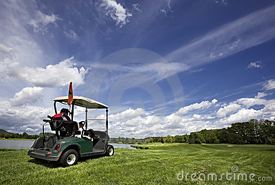 Golf cart on golf course and wonderful cloudy sky