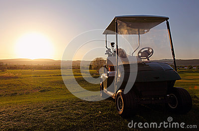 Golf cart over nice green