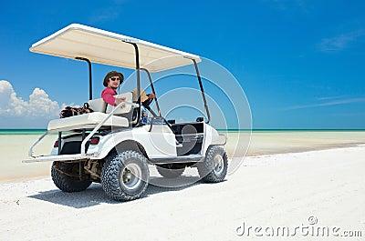 Golf cart at tropical beach