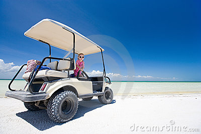 Golf cart at tropical beach