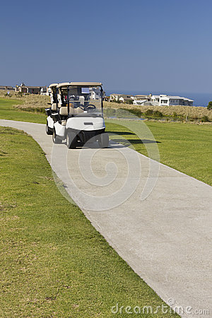 Golf carts on golf course road