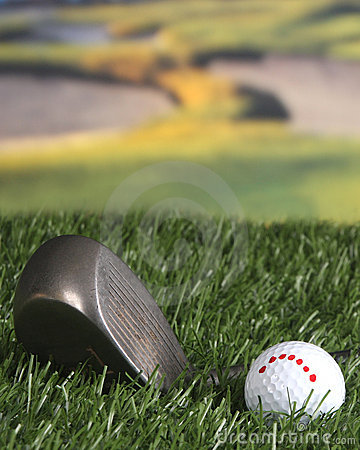 Golf club and ball on the fairway