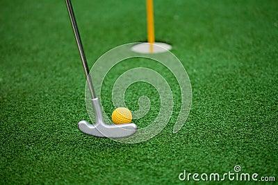 Golf club, ball and hole