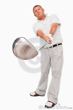 Golf club being used