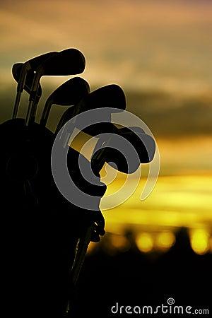 Golf clubs at dawn