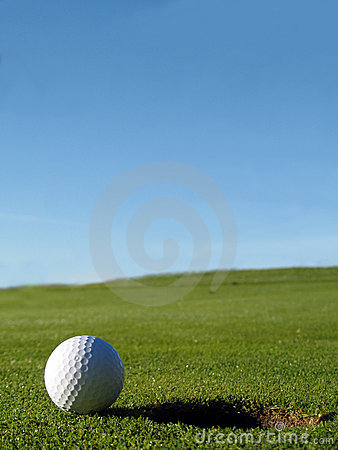 Free Golf Course Ball Beside Hole Royalty Free Stock Photography - 16040347