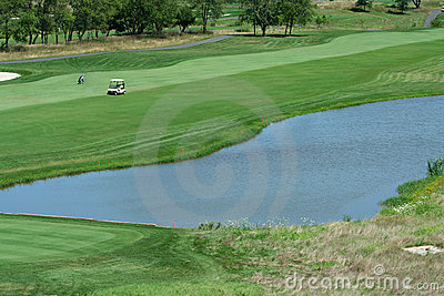 Golf course fairway with water hazard