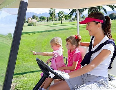 Golf course family mother and daughters in buggy