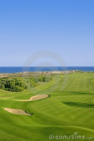 Golf course green grass near sea ocean