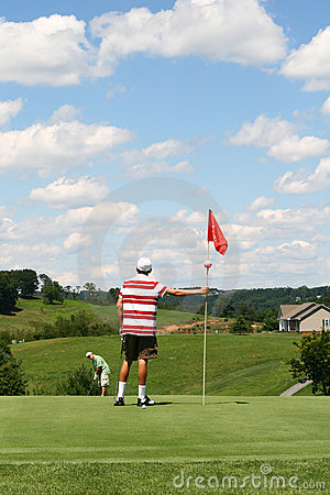 Golf - Father Putting Ball at Son Tending Flag