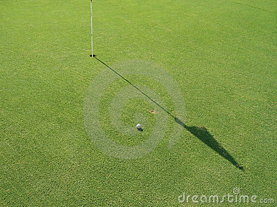 Golf field with flag and ball