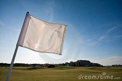 Golf flag on a sunny afternoon