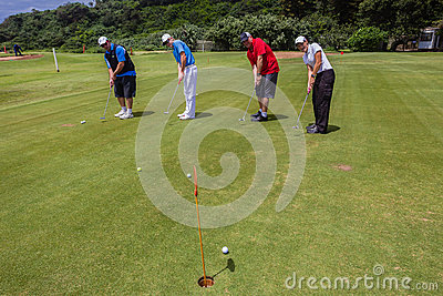 Golf Four-Ball Team Putting  Editorial Stock Image