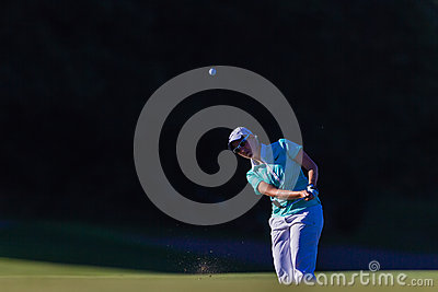 Golf Pro Girl Chip Ball Flight  Editorial Stock Photo