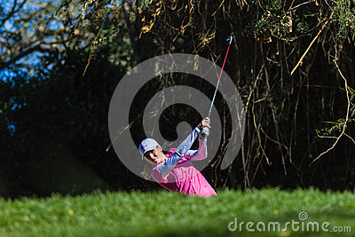 Golf Girl Iron Follow Through Editorial Image