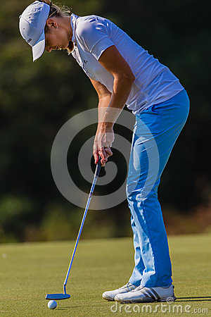 Golf Girl Putt Focus  Royalty Free Stock Photo - Image: 26979115