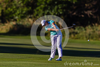 Golf Girl Fairway Swing Ball  Editorial Stock Photo