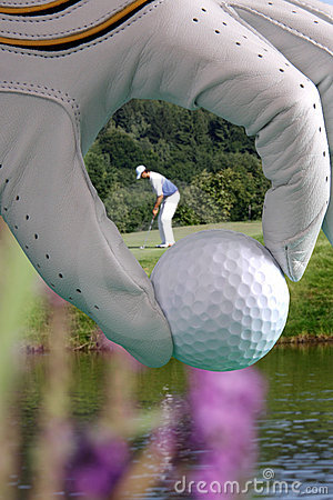 Golf glove with ball and with golfer
