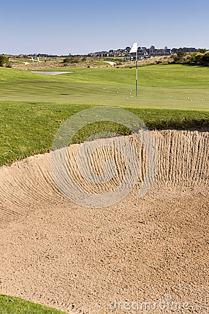 Golf green on course with bunker