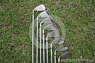 Golf irons on the fairway grass