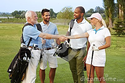 Golf partners shaking hands