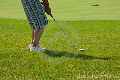 Golf player on green