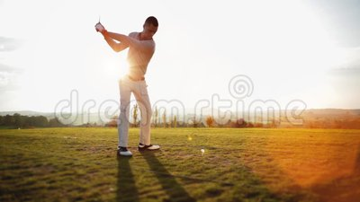 Golf player hits golf ball. Playing golf on a beautiful summer morning - powerful drive stock footage
