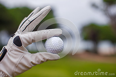 Golf player man holding golf-ball in his hand