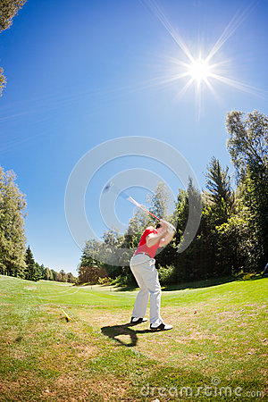 Golf player performs a swing